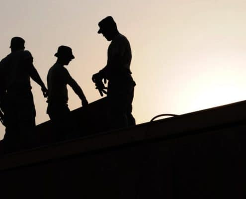 Maintenance/construction workers on site. Photo Credit: Pexels.